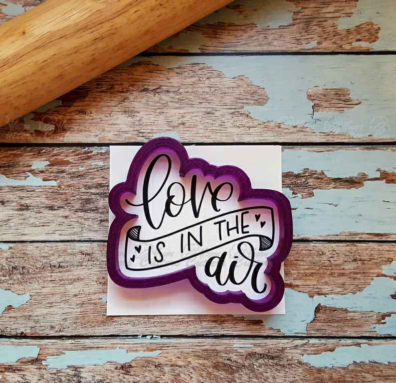 Love Is In The Air Hand Lettered Cookie Cutter and Fondant Cutter and Clay Cutter with Optional Stencil,                       letter cookie cutters, cursive letter cookie stamp, cursive letter fondant cutters, fancy letter cookie cutters, large letter cookie cutters, letter shaped cookie cutters, 8 inch round cookie cutter, cookie shapes by hand, dog cookie cutters near me, mini gingerbread cookie cutter, mini gingerbread house cutters, custard cream biscuit cutter, micro cookie cutters, party hat cookie cutter,