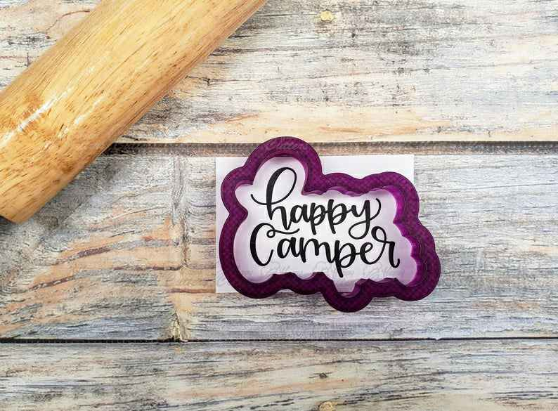 Happy Camper Hand Lettered Cookie Cutter and Fondant Cutter and Clay Cutter,                       letter cookie cutters, cursive letter cookie stamp, cursive letter fondant cutters, fancy letter cookie cutters, large letter cookie cutters, letter shaped cookie cutters, pacifier cookie cutter, lion cookie cutter, trolley cookie cutter, emoji cutters, tool cookie cutters, cookie plunger, sugarbelle halloween cookie cutters, hockey cookie cutters,