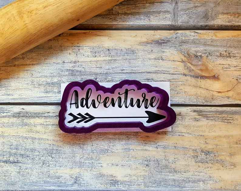 Adventure Arrow  or Adventure Hand Lettered Cookie Cutter and Fondant Cutter and Clay Cutter with optional stencil,                       letter cookie cutters, cursive letter cookie stamp, cursive letter fondant cutters, fancy letter cookie cutters, large letter cookie cutters, letter shaped cookie cutters, present cookie cutter, 3 inch biscuit cutter, eevee cookie cutter, large pumpkin cookie cutter, feet cookie cutter, wilton mini christmas cookie cutters, rbv birkmann cookie cutters, dog biscuit cookie cutter,