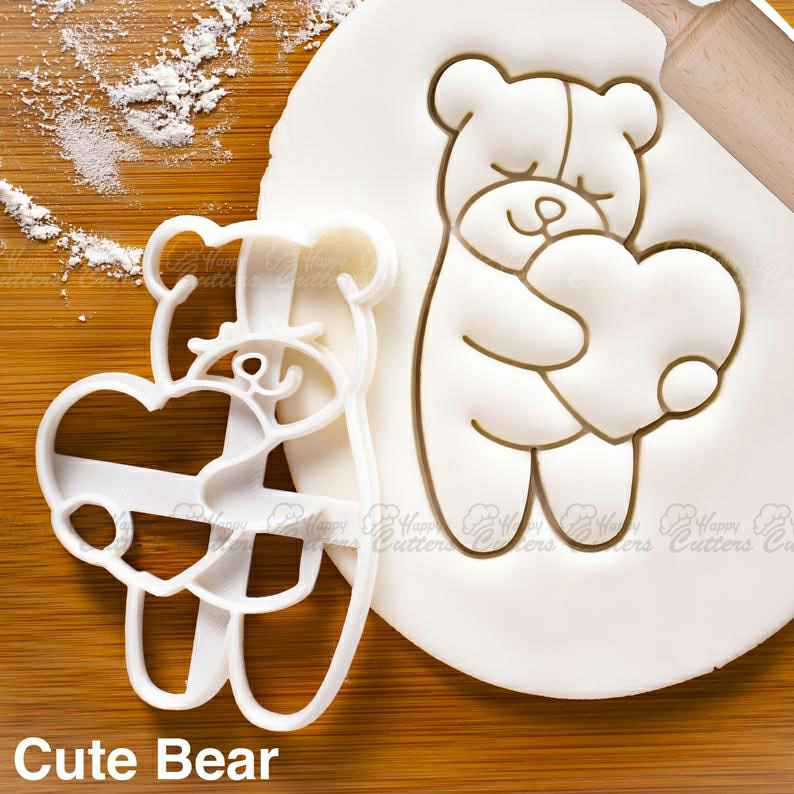 Cute Bear Hugging a Heart cookie cutter - Bake teddy bear shaped biscuits for Valentine's Day,                       heart cookie cutter, heart shaped cookie cutter, heart cutter, heart shape cutter, mini heart cookie cutter, love heart cookie cutter, kroger cookie cutters, four leaf clover cookie cutter, industrial cookie cutter, cookie cutters ireland, key shaped cookie cutter, cookie cutters poundland, large dog bone cookie cutter, crown cookie cutter walmart,